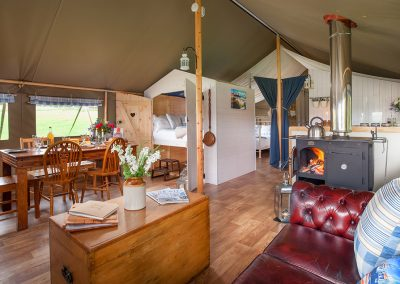 Lodge Interior living space and dining area - Lower Keats Glamping Devon